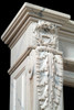 The legs of the Auguste French marble mantel have acanthus leaf and wreath details