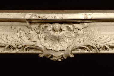 Center of the Fontaine marble mantel in ribera brown