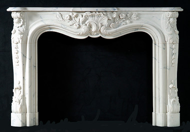 The Louis XV styling is exquisite. Carrara White Marble.