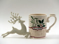 They'll love this elegant 12 oz. porcelain mug and resin glitter reindeer ornament