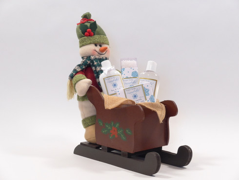 Snowman sleigh with Snowflake bath and body collection from Homespun Naturals.