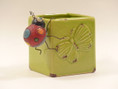 Sweet butterfly planter and ladybug decor make a lovely gift.