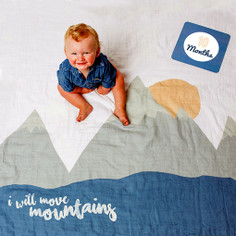 """I will move mountains"" muslin blanket is the perfect setting for baby boy"
