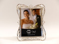 Silver plated metal frame with crystals holds 5x7 photo. Includes velvet solid backing.