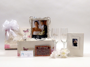 Wedding Wishes Gift Basket includes crystal champagne glasses, silver plated frame, Art of Marriage poem and more