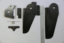 Kayak - Kick-up rudder parts, showing rudder cheeks with spring stop and screw, shaft and hinge tab; rudder spring; rudder crossbar; rudder assembly; blades in different sizes
