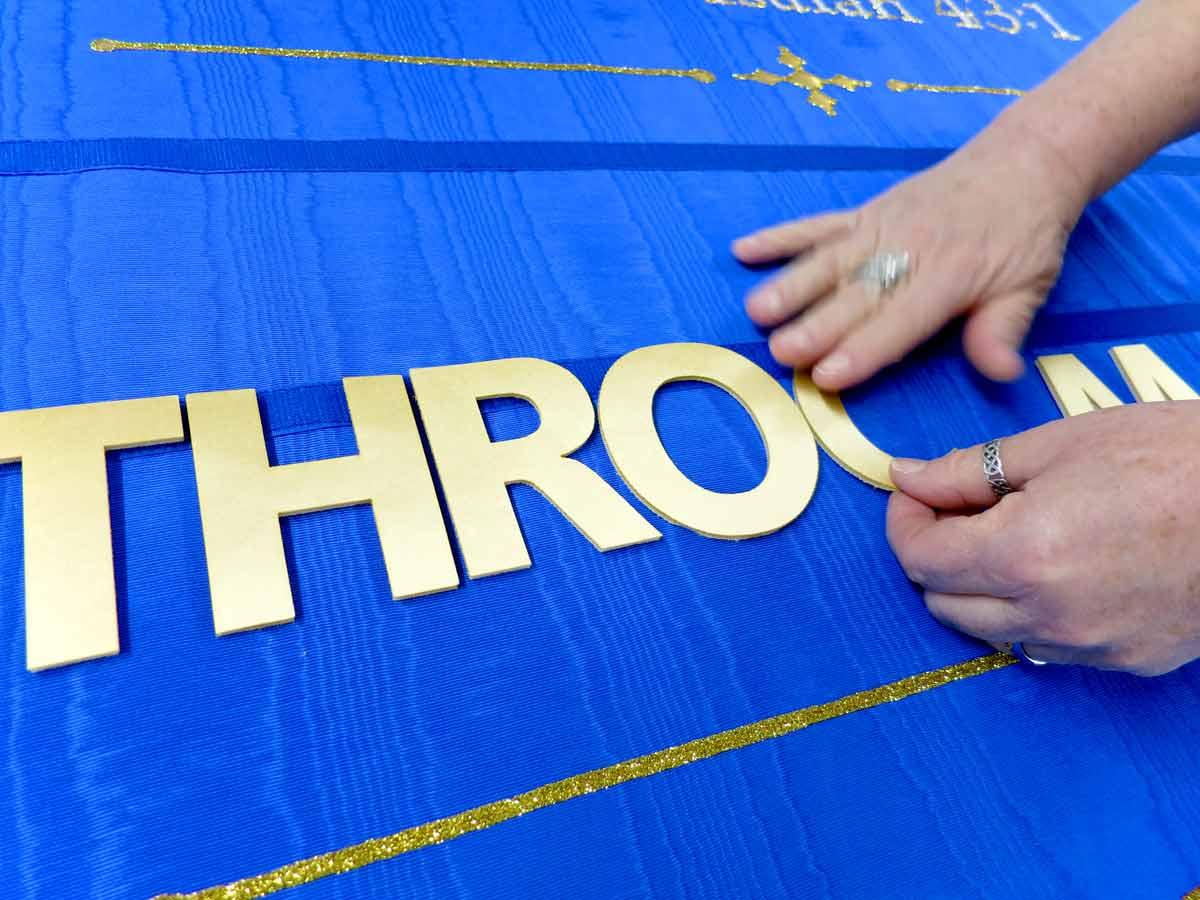 gold-letters-on-banner-1.jpg