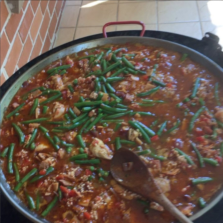 Letting the paella simmer in the stock