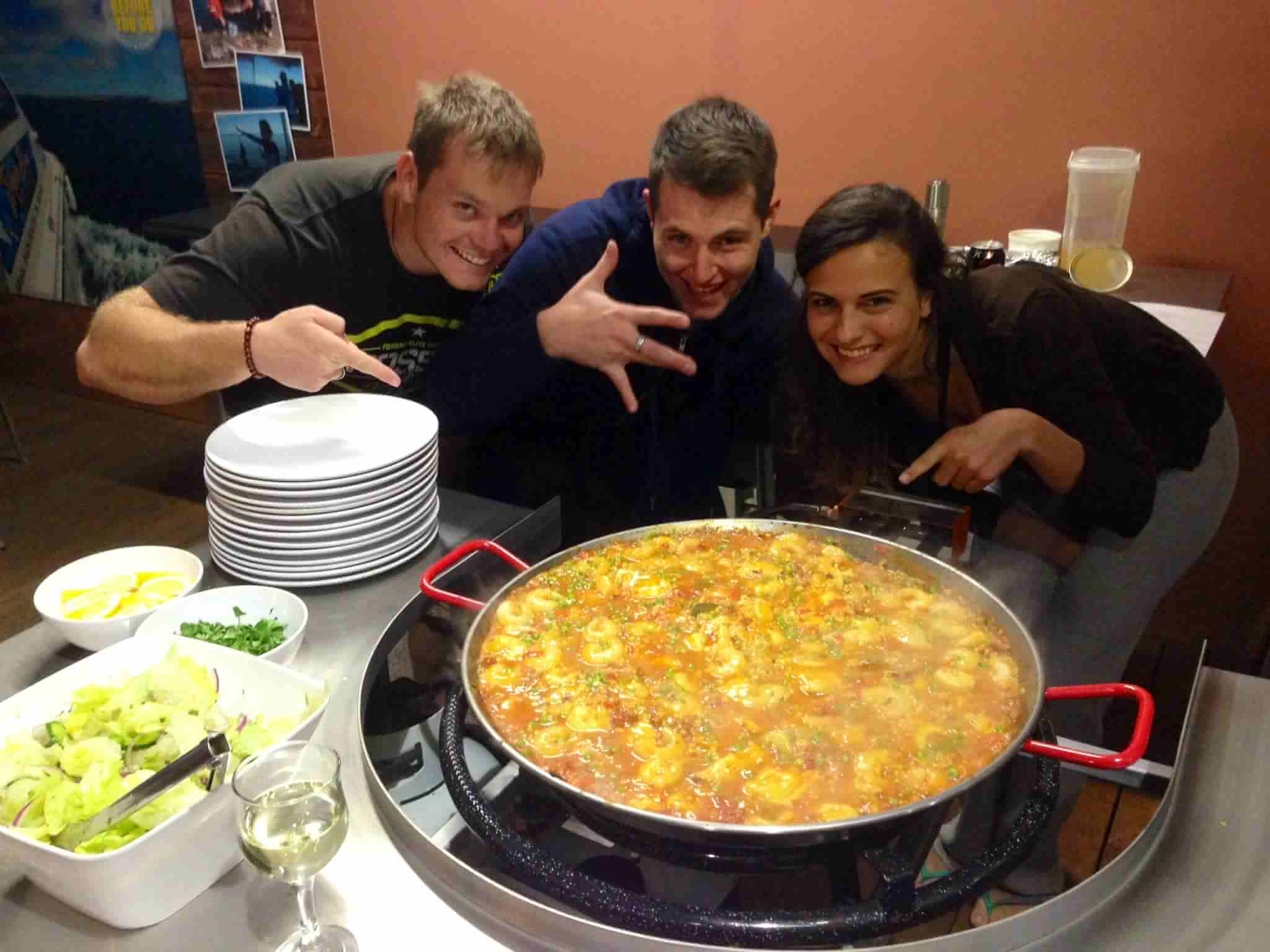 The guests get in on the Paella Action !