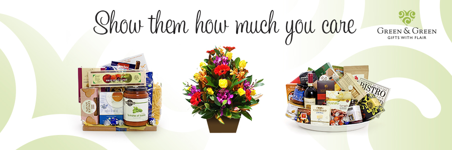 Two large gift baskets and a bouquet.