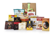 Gourmet gift basket featuring sweet and savoury snacks (chocolate, chips, crackers, etc.) packaged in signature Green & Green gift box with green ribbon and bow.