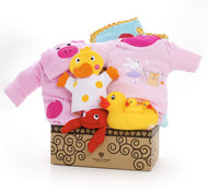Gift basket for new baby, featuring pink clothing, pink terry-cloth towels, and waterproof toys.