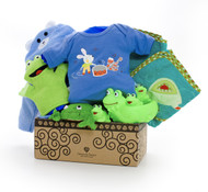Gift basket for new baby, featuring blue clothing, blue terry-cloth towels, and waterproof toys.