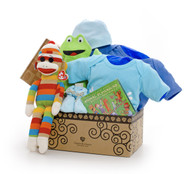 Gift basket for new baby, featuring blue clothing, rainbow sock monkey, and toys.
