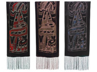 Three velvet scarves with West Coast First Nations' design by K. Tait. Each scarf has the same pattern in different colours on a black background. One is red, one is gold, and one is blue.