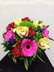 Large bouquet featuring bright flowers.
