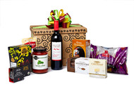 Gourmet gift basket featuring Mission Hill cabernet merlot, and savoury snacks (crackers, cheese, pasta, etc.) packaged in signature Green & Green gift box with green and orange ribbon and bow.