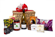 Gourmet gift basket featuring Gray Monk chardonnay, and savoury snacks (crackers, cheese, pasta, etc.) packaged in signature Green & Green gift box with red ribbon and bow.