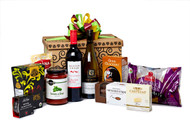 Gourmet gift basket featuring Hester Creek cabernet merlot, Gray Monk chardonnay, and savoury snacks (crackers, cheese, pasta, etc.) packaged in signature Green & Green gift box with green and orange ribbon and bow.