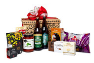 Gourmet gift basket featuring two 650mL bottles of BC local beer, and savoury snacks (crackers, cheese, pasta, etc.) packaged in signature Green & Green gift box with red ribbon and bow.
