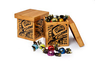 Bamboo box with West Coast First Nations design, filled with assorted chocolate truffles.