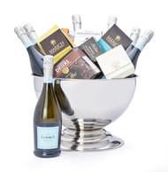 Gourmet gift basket featuring seven bottles of La Marca prosecco, and sweet and savoury snacks (chocolate, cheese, pate, etc.), presented in a large silver bowl.