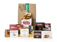 Gourmet gift basket featuring sweet and savoury snacks (chocolate, cheese, etc.) packaged in signature Green & Green gift box with green and gold ribbon and bow.
