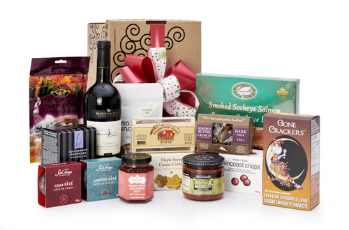 Gourmet gift basket featuring Mission Hill cabernet sauvignon, and BC local snacks (chocolate, crackers, smoked salmon, etc.) packaged in signature Green & Green gift box with red ribbon and bow.