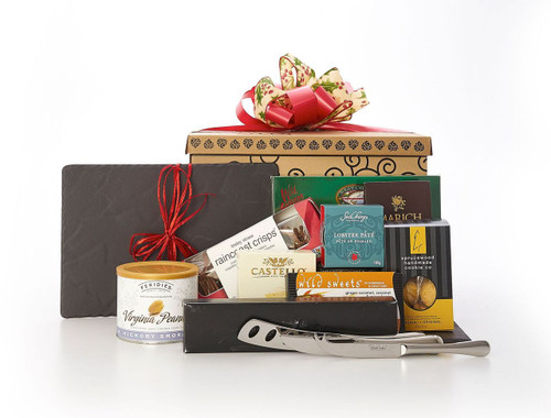 Black Revol platter, set of three Robert Welch cheese knives, and savoury snacks (cheese, pate, crackers, smoked salmon, etc.), packaged in signature Green & Green gift box with red and gold ribbon and bow.