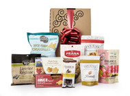 Gourmet gift basket featuring sweet and savoury snacks (chocolate, chips, crackers, cookies, etc.) packaged in signature Green & Green gift box with red ribbon and bow.