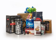 Gourmet gift basket featuring Bodum French press, travel mug with First Nations' design, Lavazza coffee, and international sweet snacks (chocolate, cookies, etc.) packaged in signature Green & Green gift box with green and blue ribbon and bow.