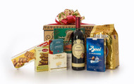 Gourmet gift basket featuring Masi Campofiorin wine, Lavazza coffee, and Italian and BC local snacks (chocolate, candies, crackers, smoked salmon, etc.) packaged in signature Green & Green gift box with red and gold ribbon and bow.
