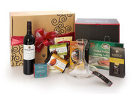 Gourmet gift basket featuring Pirramimma shiraz, BC local snacks (chocolate, crackers, smoked salmon, etc.), Riedel wine carafe and Riedel stemware, packaged in signature Green & Green gift box with red ribbon and bow.