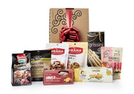 Gourmet gift basket featuring the best international snacks (cookies, candies, crackers, etc.), packaged in signature Green & Green gift box with red ribbon and bow.