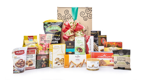 Best of international snacks (chocolate, candies, crackers, etc.) packaged in signature Green & Green gift box with red and green ribbon and bow.