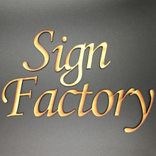 """Letter connected MDF Letters spelling Sign Factory in the Monotype font.  These letters are made from 1/8"""" thick MDF and, with the exception of the 1st capital letter,  pushed together to form one solid design."""