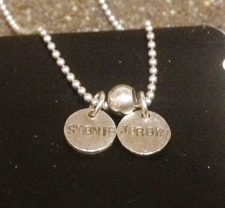Hand stamped discs necklace