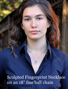 model wearing sculpted fingerprint necklace on 18