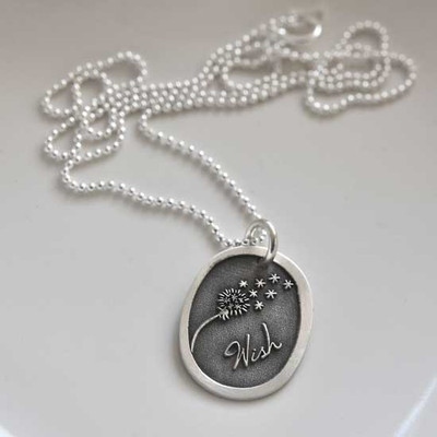 Silver Wish Dandelion Necklace, with the word Wish and picture of a dandelion blowing away, shown from the side, on gray background