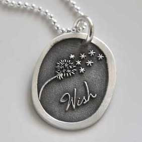 Silver Wish Dandelion Necklace, with the word Wish and picture of a dandelion blowing away, shown close up, on gray background