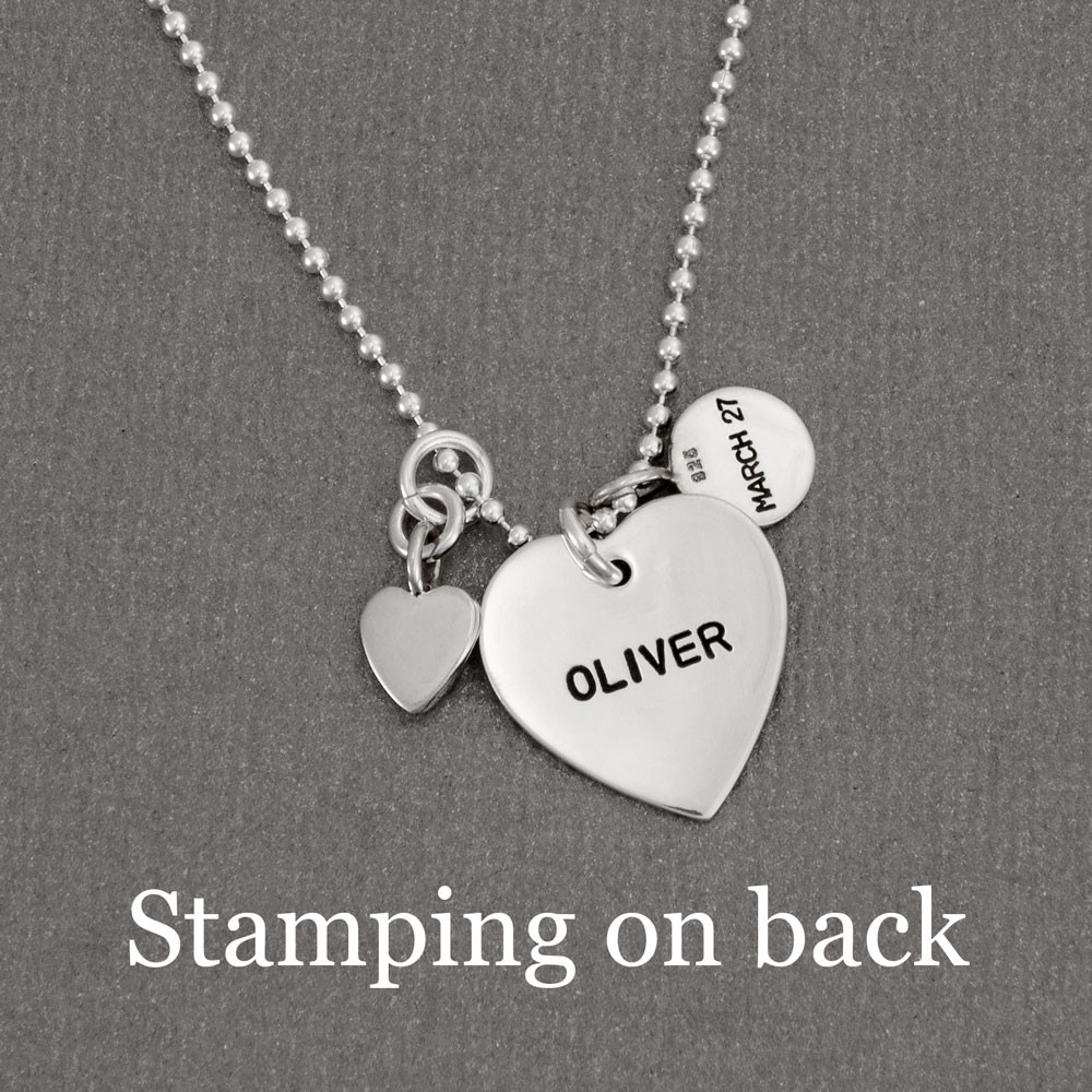 Back of silver footprints on a silver heart necklace, showing optional stamping