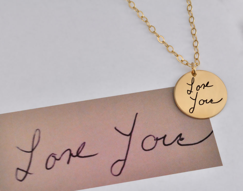 Gold handwriting disc necklace, shown with handwritten note used to make it