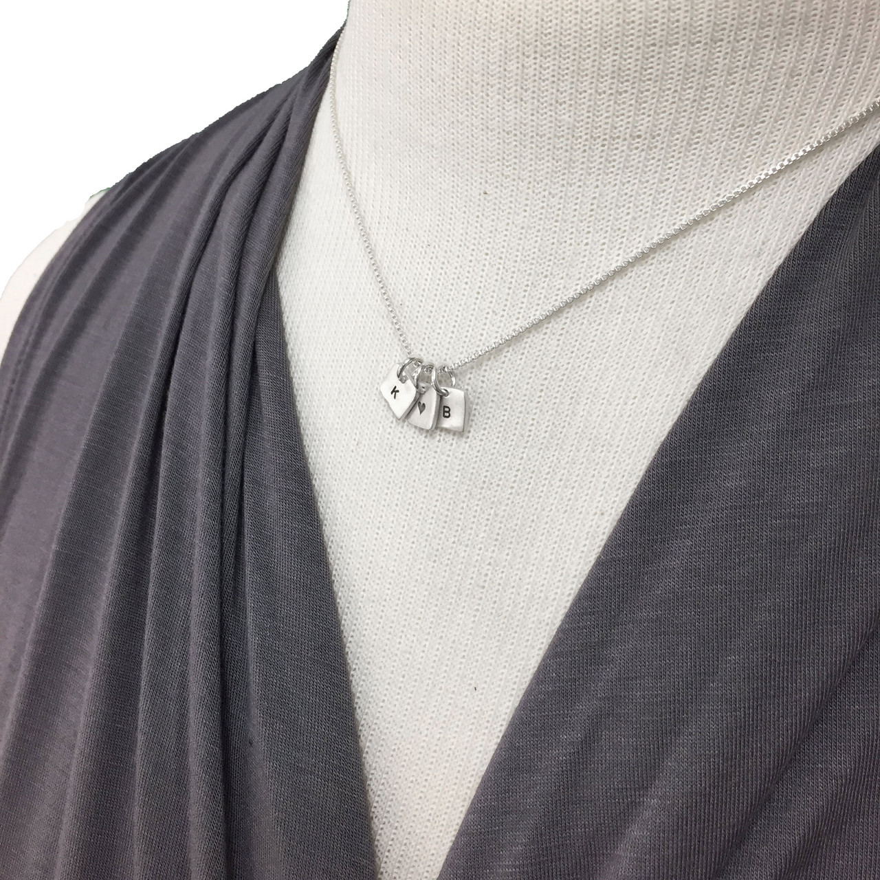 Sterling silver personalized initial necklace with tiny squares on model