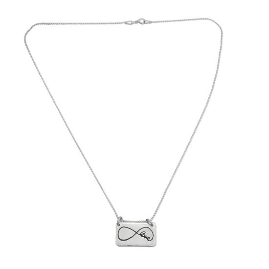 Sterling silver rectangle jewelry made from handwriting, shown on white