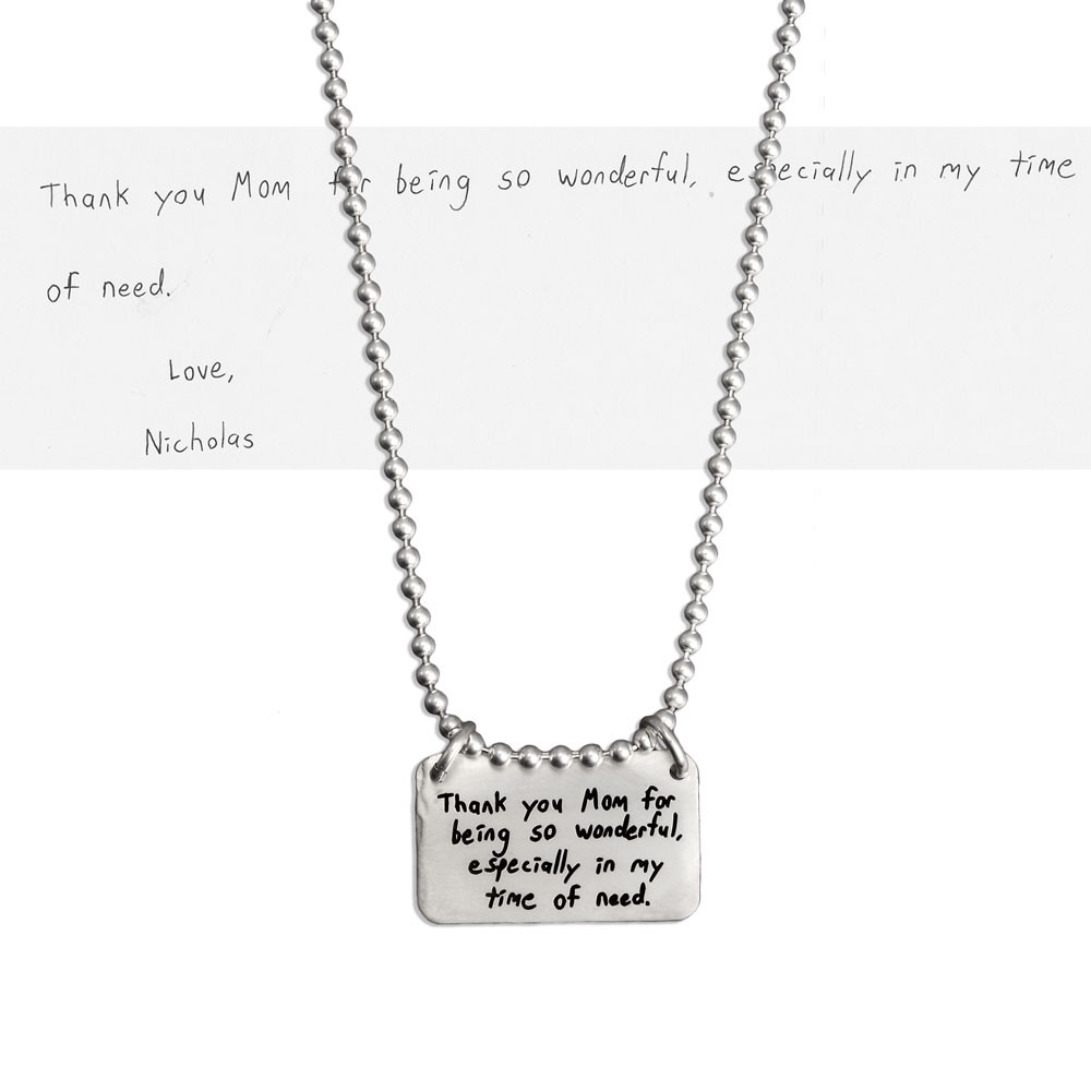 Sterling silver rectangle jewelry made from handwriting, with handwritten note for Mom on Mothers Day, shown on white