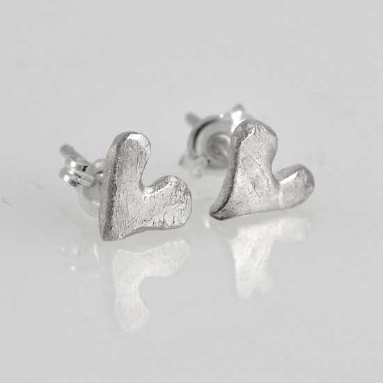 """Loved"" handmade fine silver heart earrings, shown from the side"