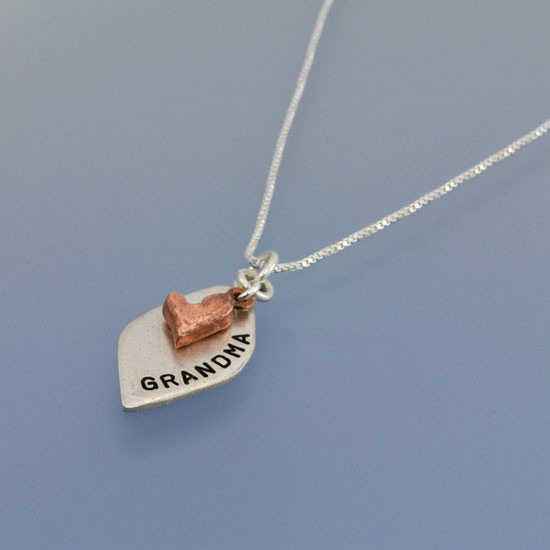 Hand Stamped Loved Petal Necklace, in fine silver and copper, shown from the side