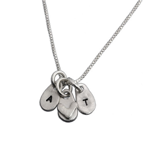 Hand Stamped Loved Tiny Initials Necklace, made from fine silver