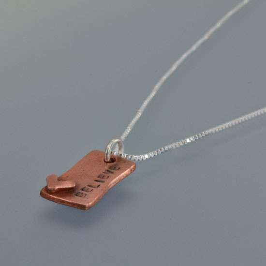 Hand Stamped Loved Copper Rectangle Necklace, close up from the side