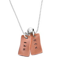 Hand stamped rectangle copper charms necklace, personalized with kids names, shown close up on white